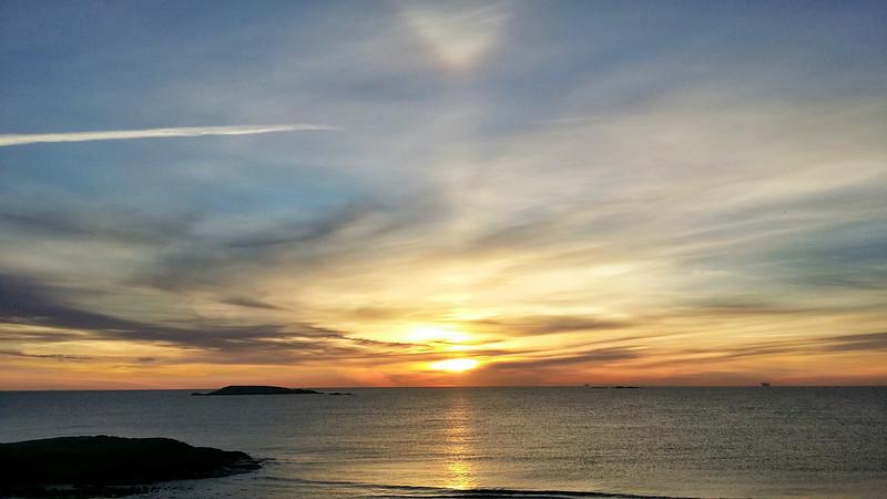 Sunrise with parhelion (sundog) above the sun.