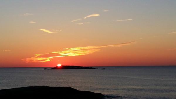 Sun behind Ram Island